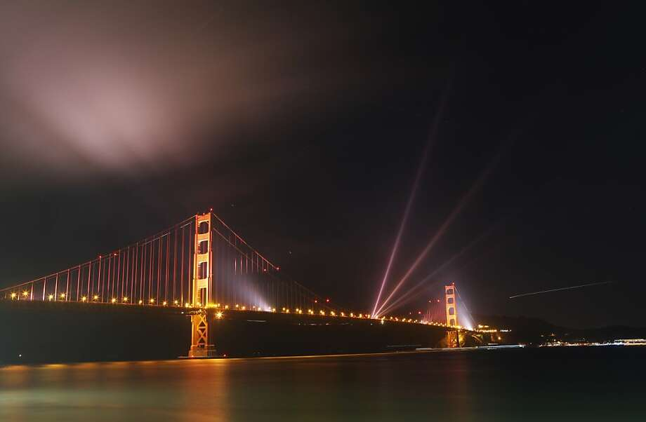 TOPSHOTS Lights illuminate the Golden Gate Bridge during the celebration of its 75th anniversary on late May 27, 2012.  Tens of thousand of people came to San Francisco's waterfront to mark the 75th anniversary of the Golden Gate Bridge, the distinctive orange vermilion structure that attracts some 10 million visitors each year.   AFP PHOTO / Kimihiro HoshinoKIMIHIRO HOSHINO/AFP/GettyImages Photo: Kimihiro Hoshino, AFP/Getty Images