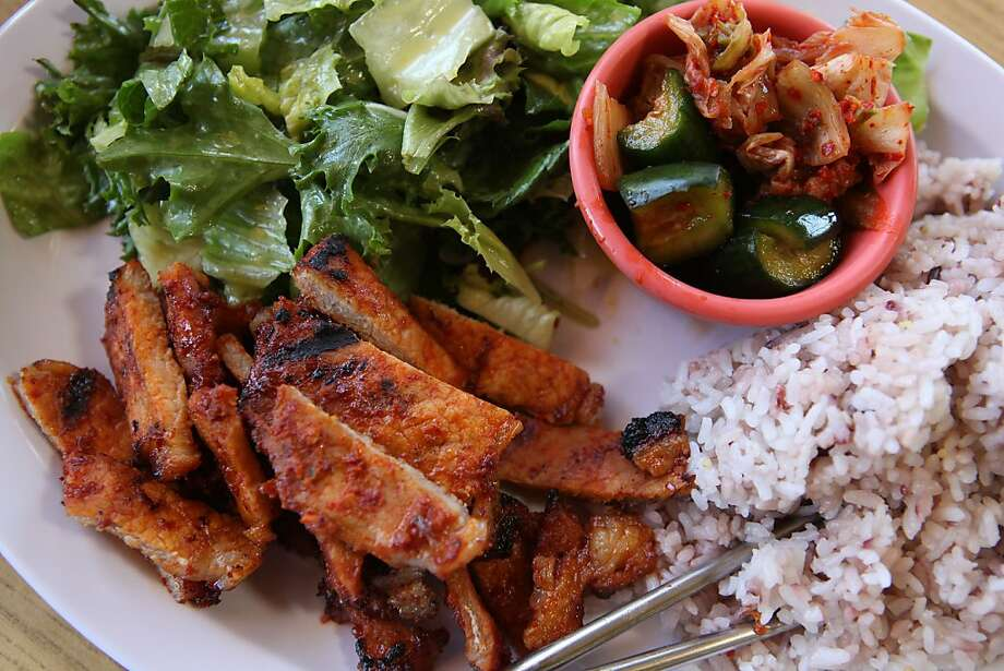 Pork Korean barbecue plate coming with homemade kimchi and grain infused rice at Menlo BBQ at 555 Willow Road in Menlo Park, California, on Wednesday, May 23, 2012.  Dressing on salad is half freshly squeezed orange juice. Photo: Liz Hafalia, The Chronicle