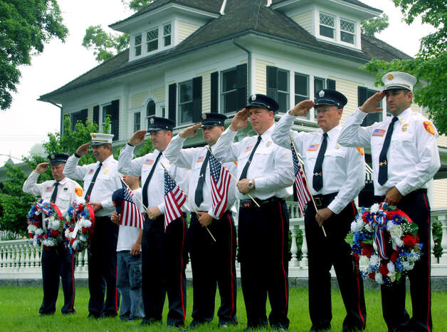 Chief Justin Planz, right, and his fellow fighters from the Bridgewater Volunteer Fire Department offer a solemn salute Monday in tribute to our nation's war dead, May 28, 2012 during the Bridgewater Memorial Day ceremony. Photo: Walter Kidd