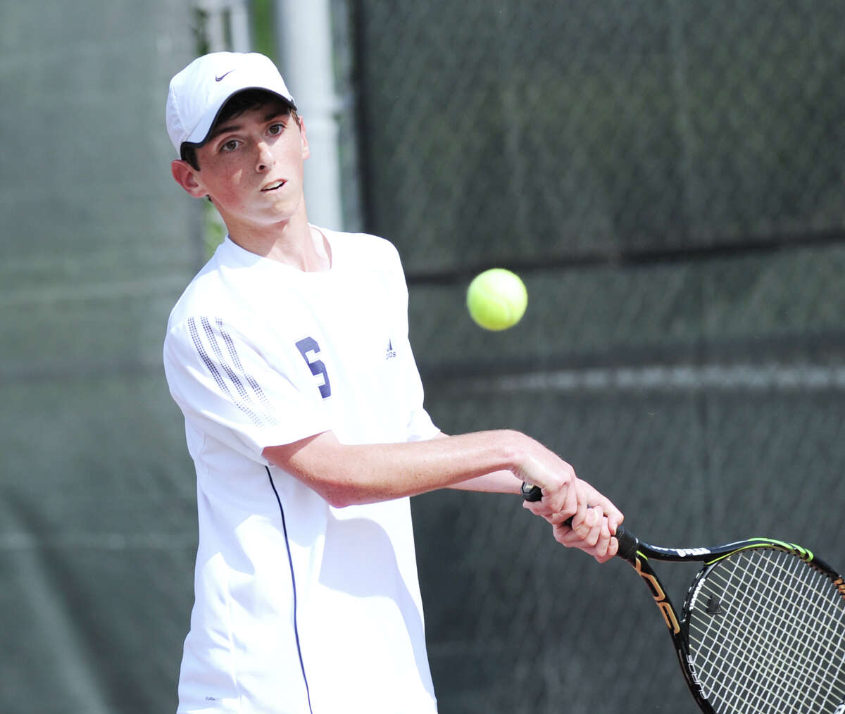 Baxter Stein of Staples in his match against Blake Niehaus of Greenwich during the FCIAC boys tennis championship between Staples High School and Greenwich High School at Wilton High School, Tuesday, May 29, 2012. Greenwich defeated Staples 4-0 to win the championship.