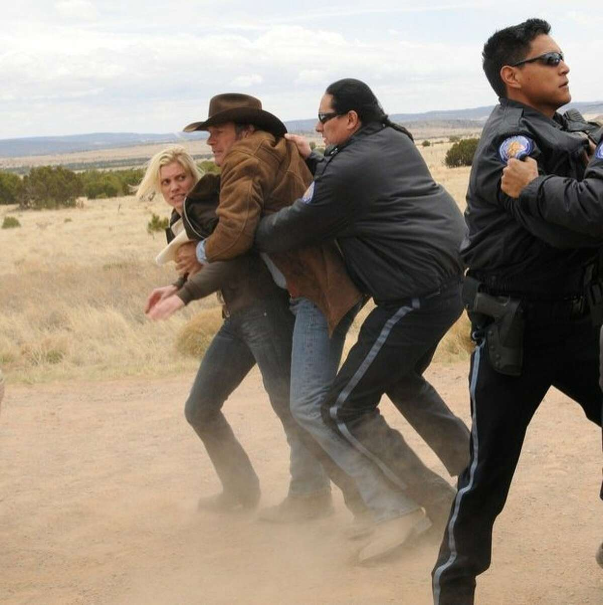 L to R: Katee Sackhoff and Robert Taylor star in A&E?•s new original drama series, ?'Longmire,?