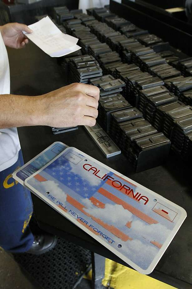 In this photo taken Tuesday, May 15, 2012 an inmate selects the letters and numbers to be used to make a Memorial specialty license plate by Prison Industries at Folsom State Prison in Folsom, Calif.  The Memorial plate is one of 10 special-interest plates Californians can buy. Proceeds go to nonprofit groups or government agencies supporting various causes.  Money raised from the Memorial plate is used to help California's law enforcement fight threats against terrorism in the state. (AP Photo/Rich Pedroncelli) Photo: Rich Pedroncelli, Associated Press