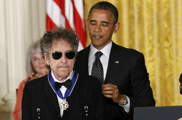 President Barack Obama presents rock legend Bob Dylan with a Medal of Freedom,  Tuesday, May 29, 2012, during a ceremony at the White House in Washington. (AP Photo/Charles Dharapak) Photo: Charles Dharapak, Associated Press