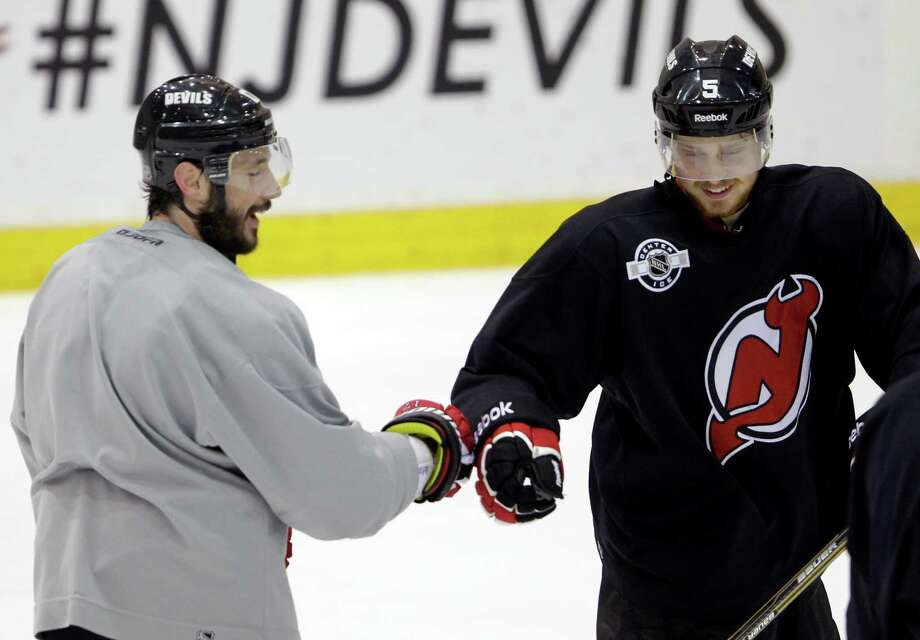New Jersey's Ilya Kovalchuk (left) will face the Kings after spurning them in free agency nearly two years ago. Photo: AP