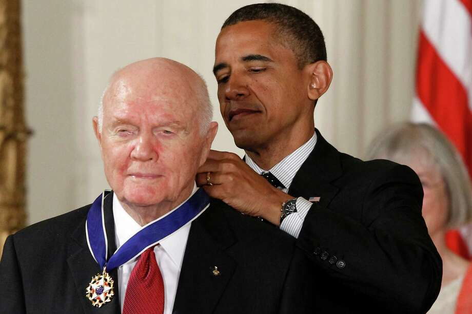 President Barack Obama awards the Medal of Freedom to astronaut John Glenn during a ceremony in the East Room of the White House in Washington, Tuesday, May 29, 2012. The Medal of Freedom is the nation's highest civilian honor. It's presented to individuals who have made especially meritorious contributions to the national interests of the United States, to world peace or to other significant endeavors. (AP Photo/Charles Dharapak) Photo: Charles Dharapak, Associated Press / AP