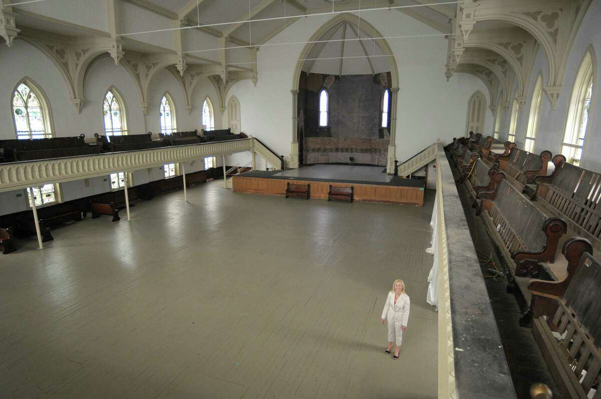 Teddy Foster, president of the board of directors for The Saratoga Springs Universal Preservation Hall, stands inside the hall on Thursday, May 24, 2012 in Saratoga Springs, NY. The church was saved from collapse years ago. (Paul Buckowski / Times Union)
