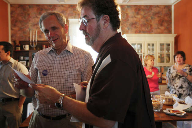 U.S. Rep Lloyd Doggett (left) gets early voting results from Bob Comeaux at the Comeaux residence on West French Place, Tuesday, May 29, 2012. Doggett was leading in early voting results out of Bexar and Travis Counties. Photo: Jerry Lara, San Antonio Express-News / © San Antonio Express-News