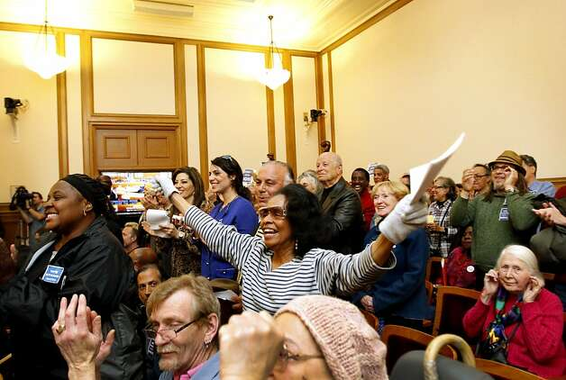 Supporters of Ross Mirkarimi cheer as he appears at a San Francisco Ethics Commission hearing at City Hall in San Francisco, Calif. Tuesday, May 29, 2012. Photo: Sarah Rice, Special To The Chronicle