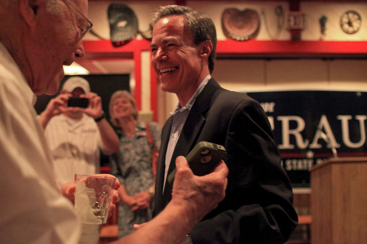 Texas House Speaker Joe Straus laughs with his father, Joe Straus Jr. (left) during the watch party for Straus supporters at the Barn Door restaurant. Straus defeated Matt Beebe in the GOP primary.