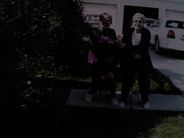 "Siblings Esther (now Cochran) and Donna Estep (now Chittenden). From Donna: ""We can no longer sit on the ground  as we did in the earlier photo (because we couldn't get up), nor can we go barefoot (see our matching house shoes), but we can be outside and sit on our canes that turn into chairs!"" Photo: COURTESY"