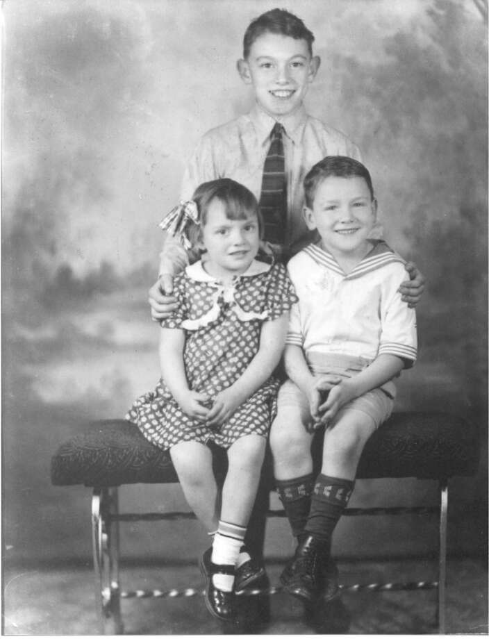 "The Brackenridge siblings Bruce (standing), Douglas and Ida Mae. c. 1935. From Douglas: ""Our parents, John and Azile Brackenridge, were Scottish immigrants who came to the United States in the 1920s and settled in Youngstown, Ohio where our father worked in the local steel mills as a bricklayer. The Depression of the 1930s hit the city hard with an unemployment rate of 30 percent. Our parents rarely took photographs and only three photos of us as children, taken by a professional photographer at bargain prices, have survived.  It was only on such occasions that we put on 'Sunday clothes.' "" Photo: COURTESY"