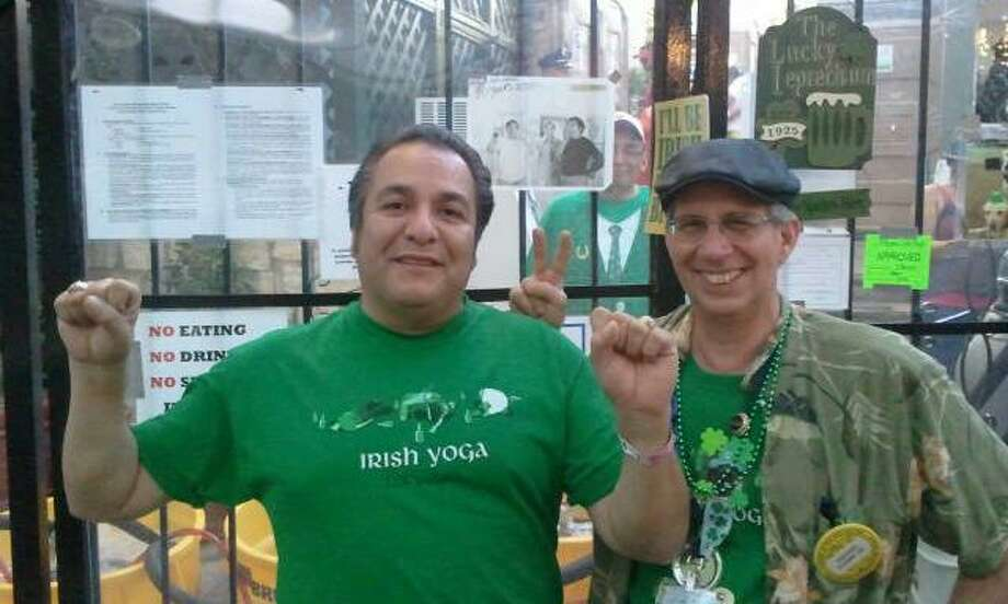 Now: Friends Rick Klamm and Mark Carrillo in 2012. They are at NIOSA working the beer booth in the Irish Flats section and holding a photo of the two of them taken 40 years earlier. Photo: COURTESY