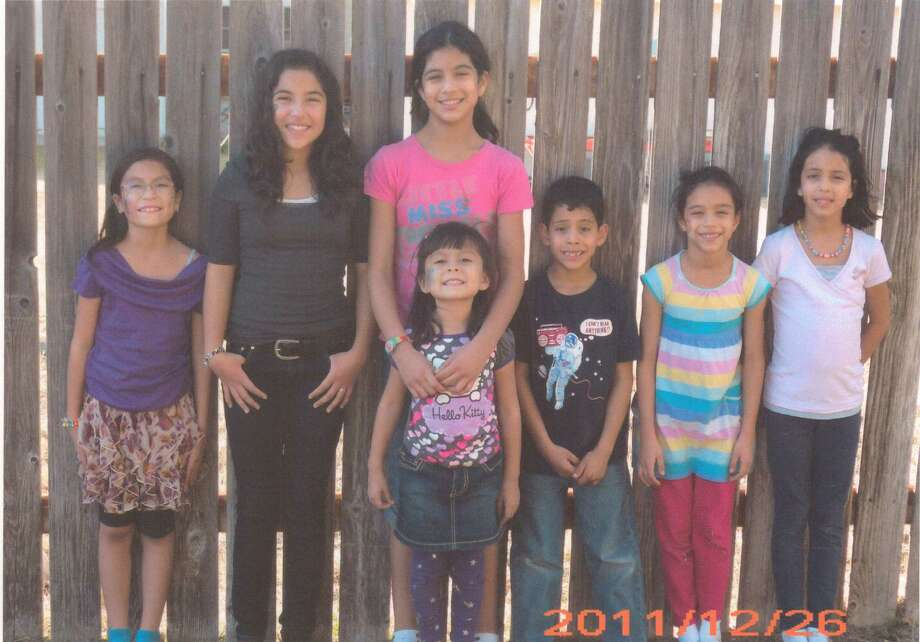 Sophia Hernandez (from left), Brianna Salinas, Victoria Hernandez, Jose Hernandez III, Cristina Hernandez, Alessia Hernandez and Maya Hernandez in front of Victoria Hernandez, December 2011, Del Rio. Photo: COURTESY