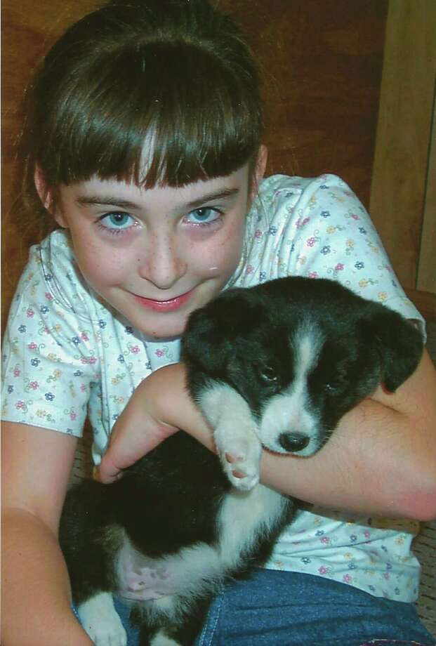 Then:Morgan Priddy, 8, with Bridgett, a 1-year-old Welsh Corgi, Austin,  2000. Photo: COURTESY