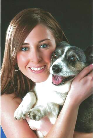 Morgan Priddy, 18, with Bridgett, an 11-year-old Welsh Corgi, Austin,  2010.Details on how to submit your photos Photo: COURTESY