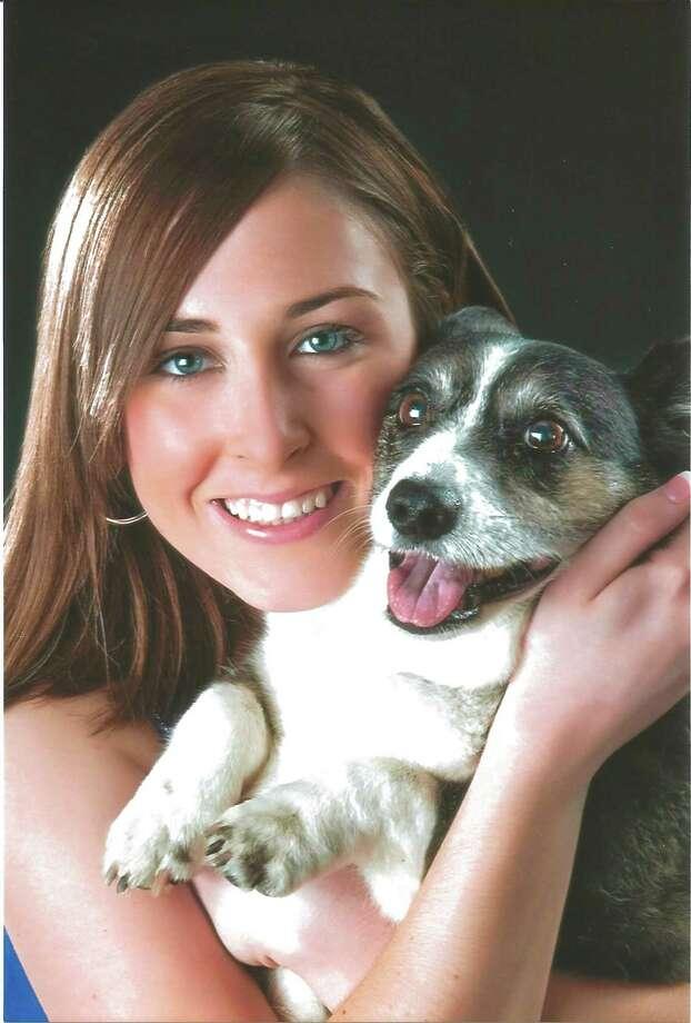 Now: Morgan Priddy, 18, with Bridgett, an 11-year-old Welsh Corgi, Austin,  2010. Photo: COURTESY