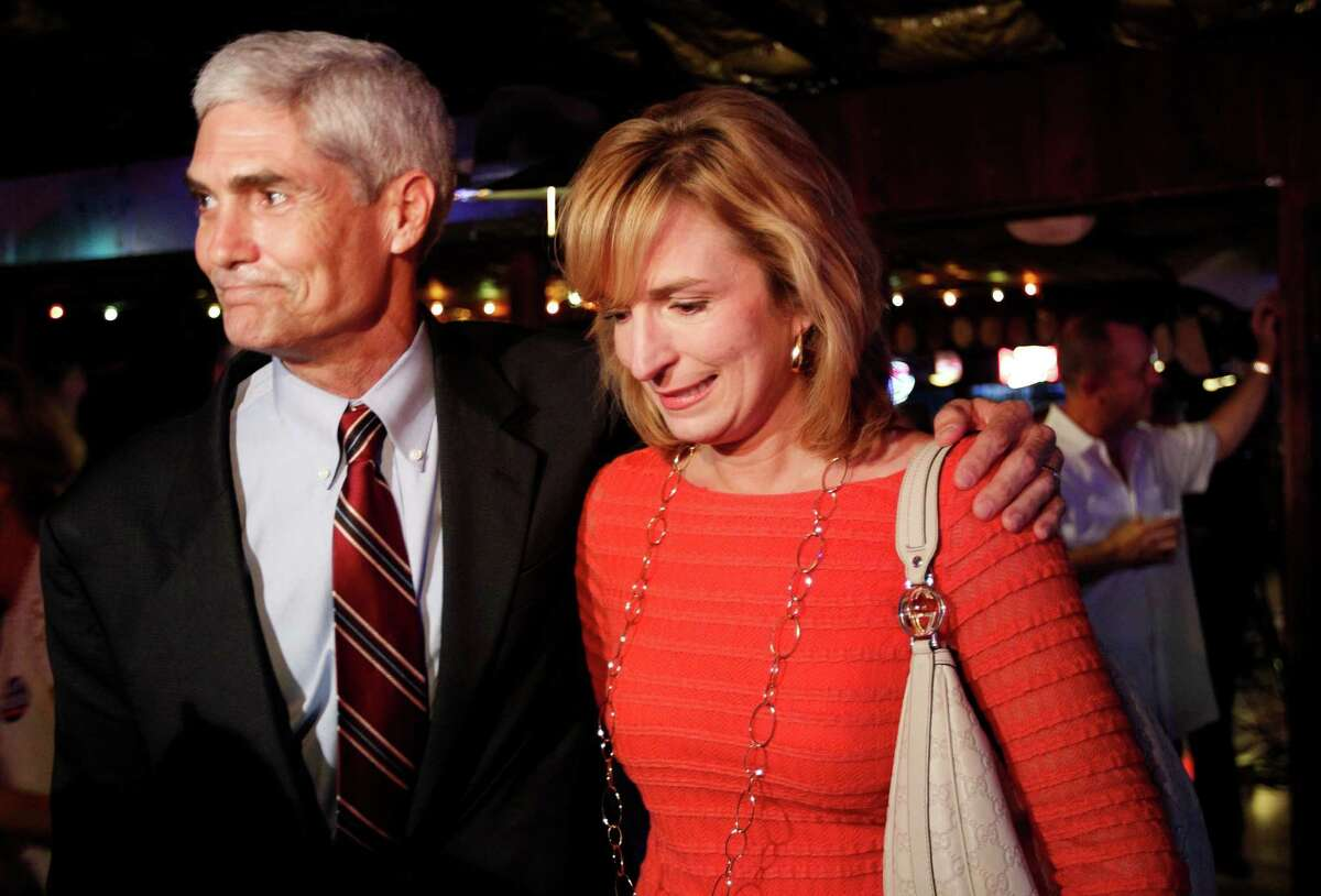 Republican candidate for Harris County District Attorney Mike Anderson and his wife Devon Anderson during Anderson's election watch party at Blanco's Bar & Grill Tuesday, May 29, 2012, in Houston.