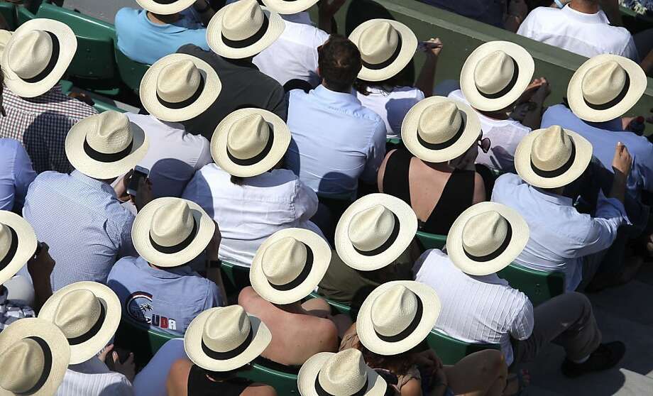 Spectators watch Serbia's Novak Djokovic playing Italy's Potito Starace during their first round match in the French Open tennis tournament at the Roland Garros stadium in Paris, Monday, May, 28, 2012.  (AP Photo/David Vincent) Photo: David Vincent, Associated Press