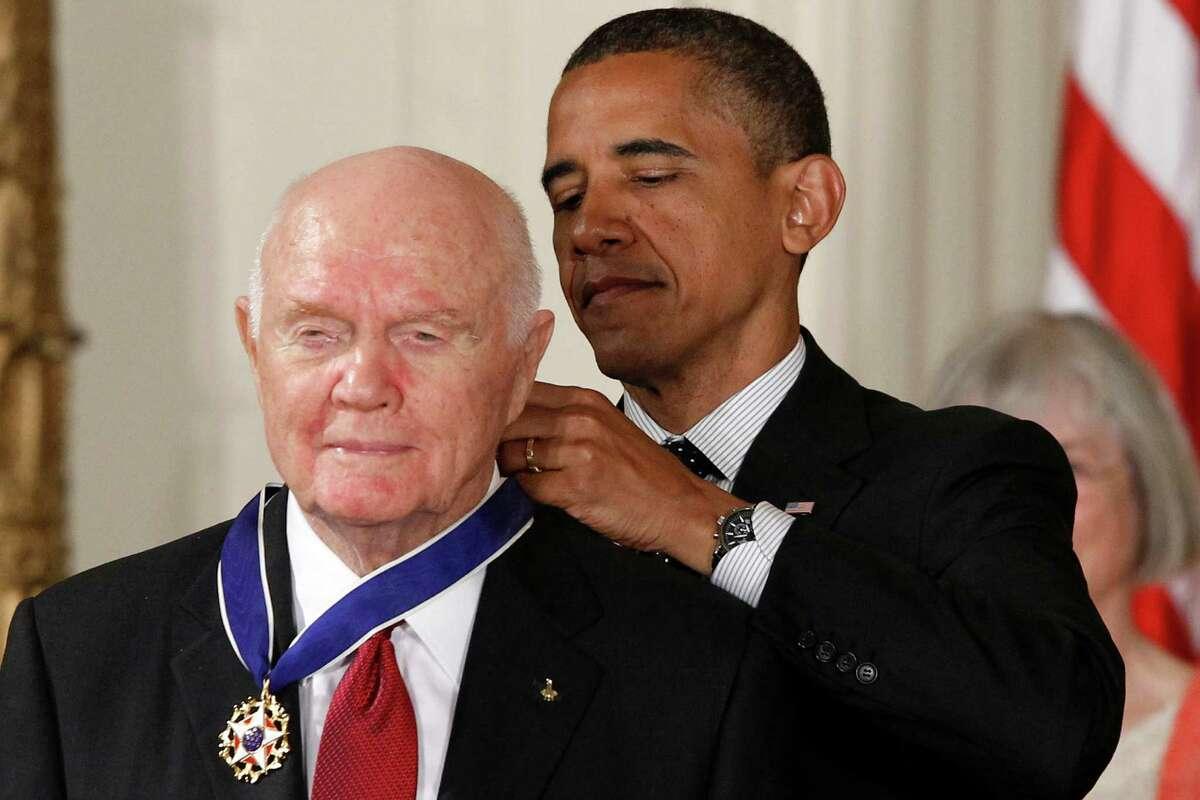 President Barack Obama awards the Medal of Freedom to former astronaut John Glenn on Tuesday.