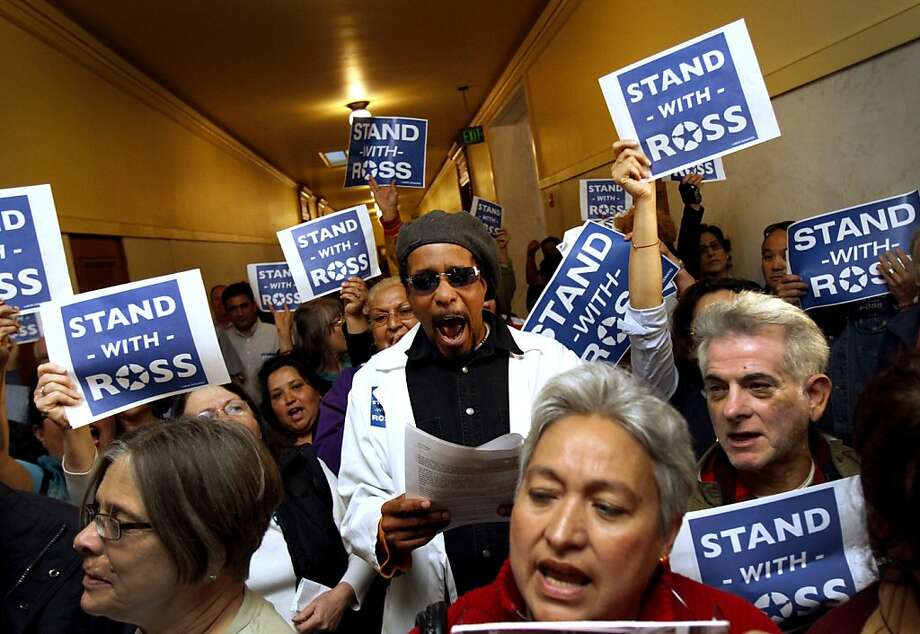 Pierre Lamont Pegeron (center) and other Ross Mirkarimi supporters cheer outside the S.F. Ethics Commission hearing. Photo: Sarah Rice, Special To The Chronicle
