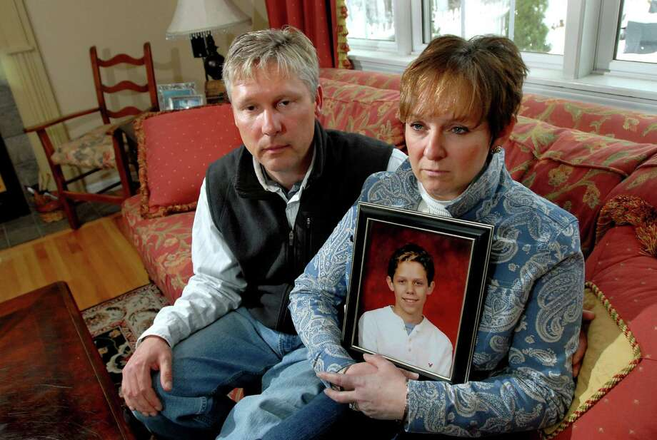 Times Union staff photo by Cindy Schultz -- Kate and David Miller pose with a portrait of their deceased son, Cody, on Friday, March 28, 2008, at their home in Queensbury, N.Y. Cody was 15 when he killed himself in August after taking the allergy / asthma drug Singulair for 17 days. (WITH CROWLEY STORY) Photo: CINDY SCHULTZ / ALBANY TIMES UNION