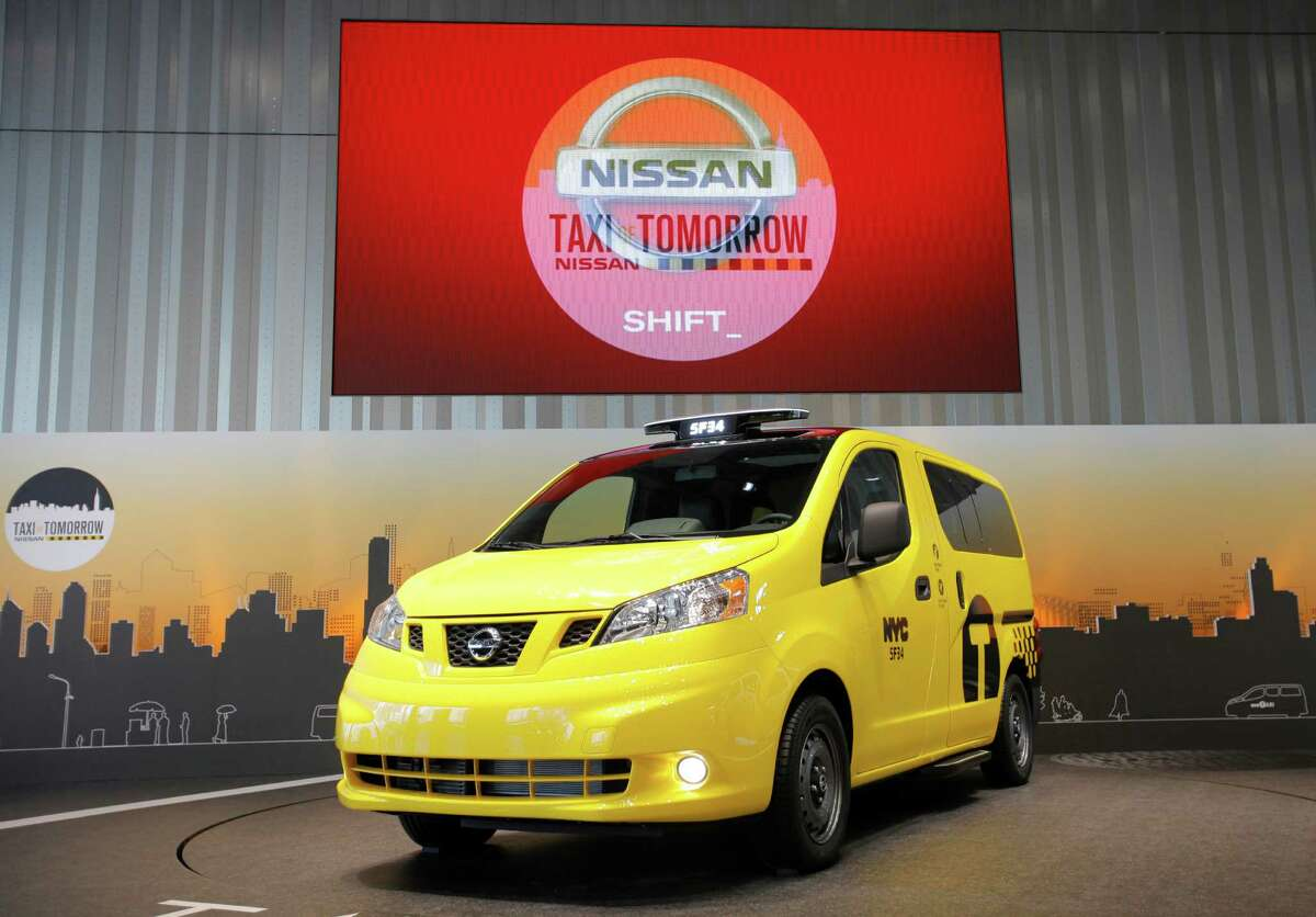 Nissan Motor Co.,'s gas-engine NV200 vehicle is displayed at the automaker's headquarters in Yokohama, near Tokyo, Tuesday, May 29, 2012. The NV200 vehicle is set to start running as New York taxis in October 2013. Nissan is supplying New York City with fuel-efficient cabs, including six electric cars for testing, but acknowledged uncertainties Tuesday about an ongoing