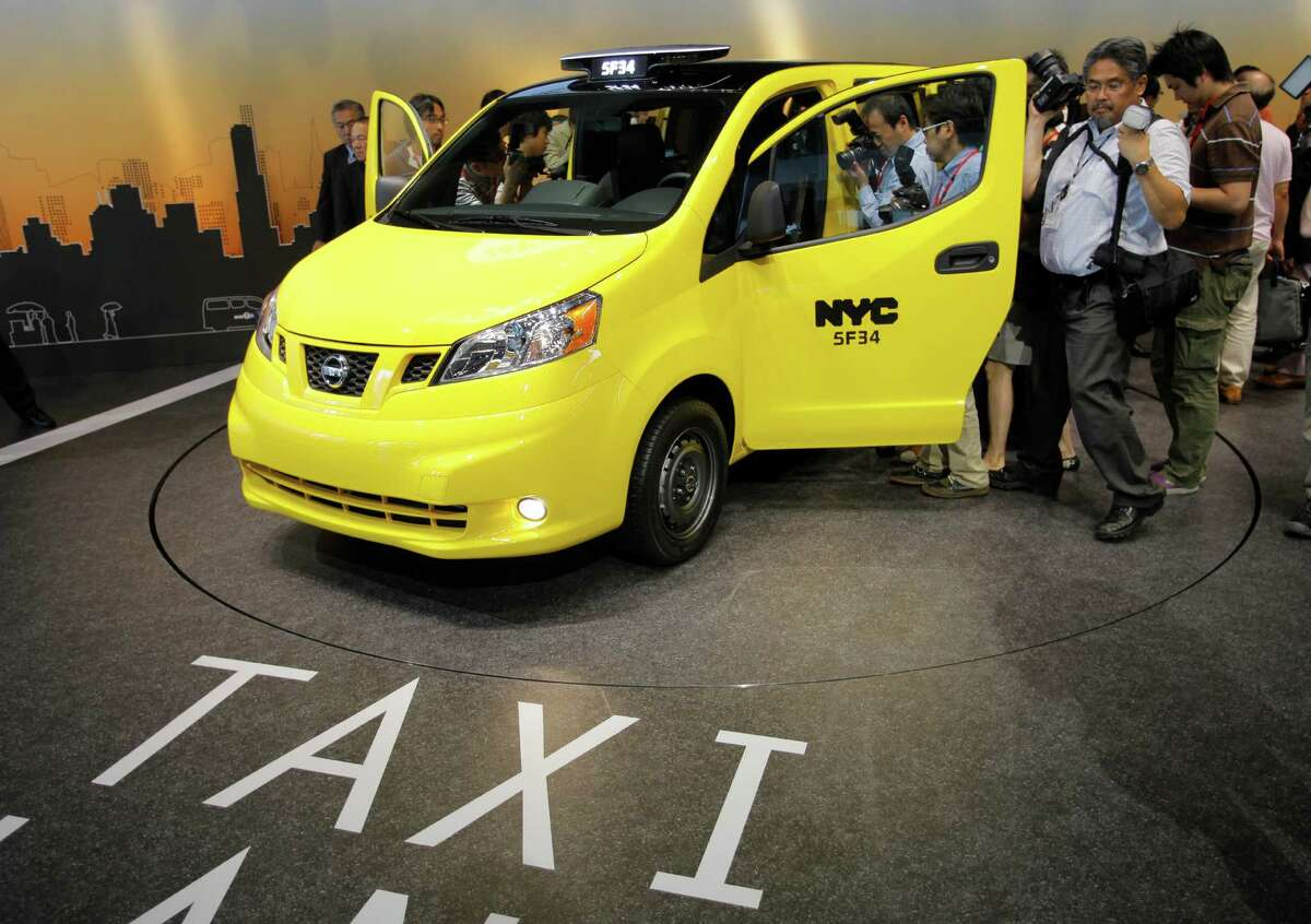 Nissan displays the NV200 at the automaker's headquarters in Yokohama. The NV200 is set to start running as New York taxis in October 2013. Nissan is supplying the city with fuel-efficient cabs, including six electric cars for testing.