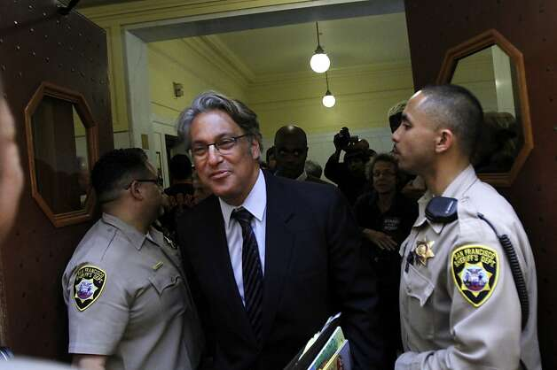 Ross Mirkarimi walks past members of the San Francisco Sheriff's Department after a recess in the San Francisco Ethics Commission hearing at City Hall in San Francisco, Calif. Tuesday, May 29, 2012. Photo: Sarah Rice, Special To The Chronicle