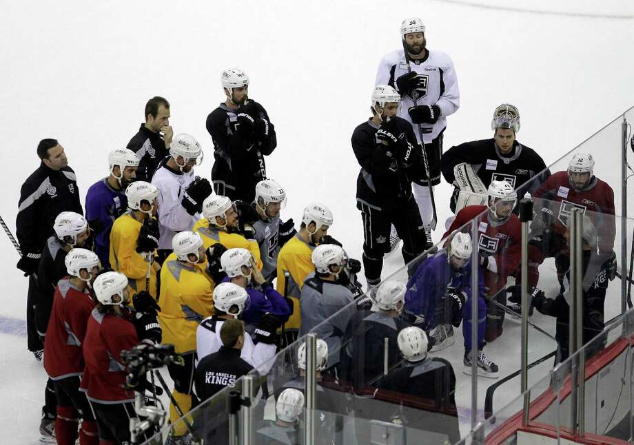 9c6edd667b4 Members of the Los Angeles Kings huddle during practice in preparation for  Wednesday's Game 1 of