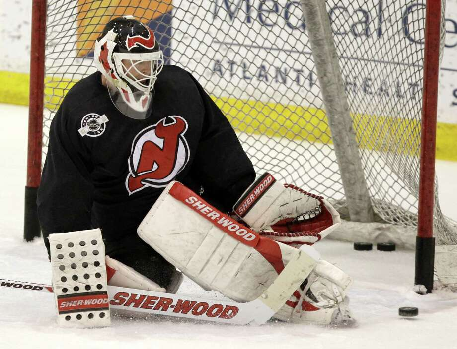 b8c184085c0 New Jersey Devils goalie Martin Brodeur makes a save during practice in  preparation for Game 1