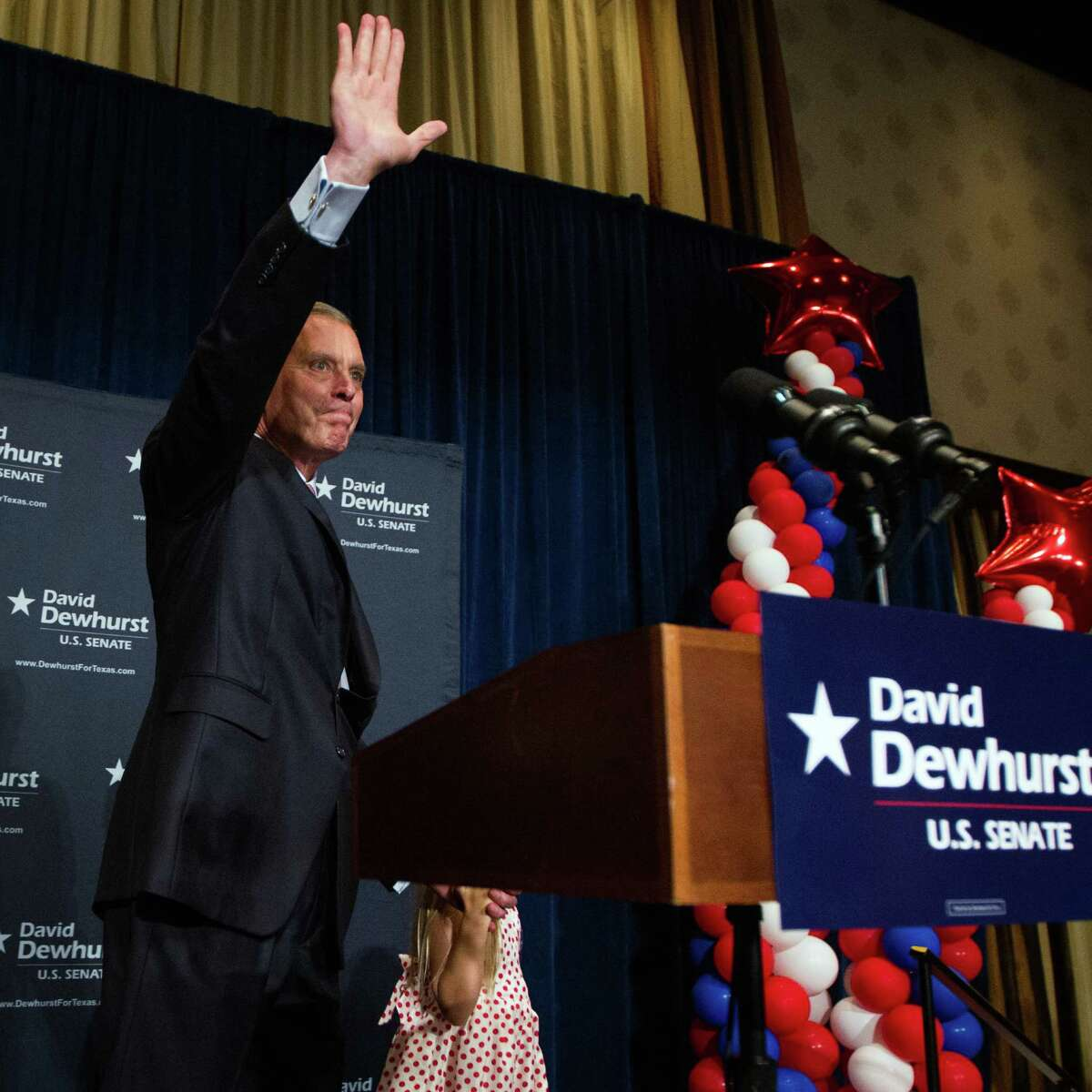 U.S. Senate candidate David Dewhurst waves to a crowd of supporters at the Intercontinental Hotel during a primary watch party on Tuesday, May 29, 2012, in Houston.