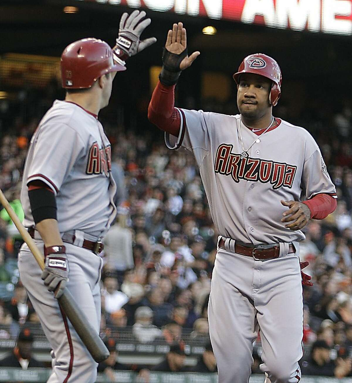 Arizona Diamondbacks' Chris Young, right, is congratulated by teammate John McDonald after scoring against the San Francisco Giants' in the second inning of a baseball game Tuesday, May 29, 2012, in San Francisco. Young scored on a single by Arizona's Josh Bell. (AP Photo/Ben Margot)