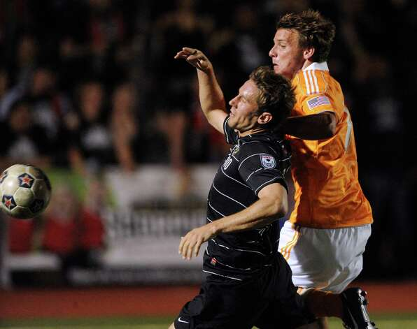 Fabian Kling (left) of the San Antonio Scorpions, is fouled by Colin Rolfe of the Houston Dynamo during U.S. Open Cup match action at Heroes Stadium on Tuesday, May 29, 2012. Photo: Billy Calzada, Billy Calzada / Express-News / © 2012 San Antonio Express-News