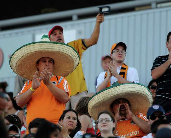 Houston Dynamo fans cheer for their team during U.S. Open Cup soccer match action against San Antonio at Heroes Stadium on Tuesday, May 29, 2012. Photo: Billy Calzada, Billy Calzada / Express-News / © 2012 San Antonio Express-News