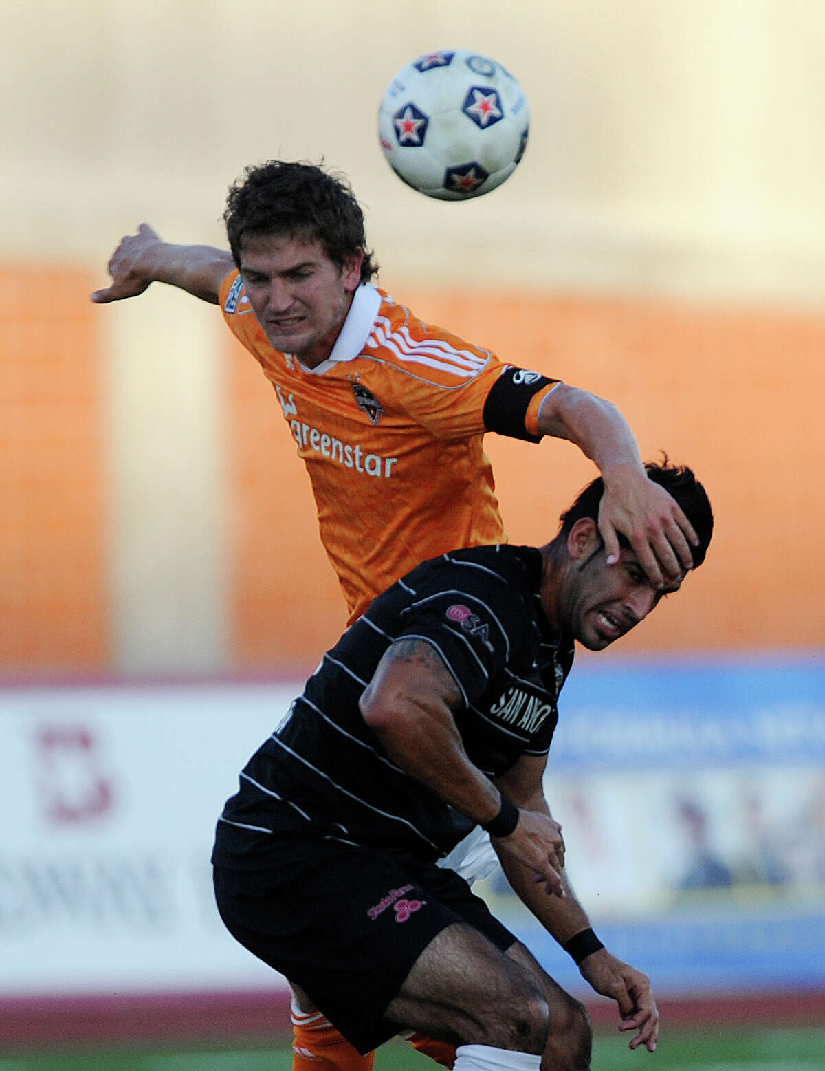 Esteban Bayona of the San Antonio Scorpions (bottom) battles with Bobby Boswell of the Houston Dynamo during U.S. Open Cup match action at Heroes Stadium on Tuesday, May 29, 2012.