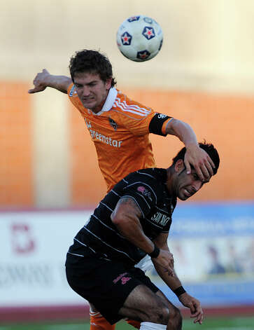 Esteban Bayona of the San Antonio Scorpions (bottom) battles with Bobby Boswell of the Houston Dynamo during U.S. Open Cup match action at Heroes Stadium on Tuesday, May 29, 2012. Photo: Billy Calzada, Billy Calzada / Express-News / © 2012 San Antonio Express-News