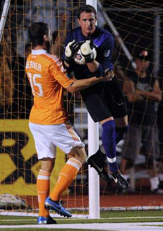 Goalkeeper Daryl Sattler of the San Antonio Scorpions catches the ball by Cam Weaver of the Houston Dynamo during action at Heroes Stadium on Tuesday, May 29, 2012. Photo: Billy Calzada, Billy Calzada / Express-News / © 2012 San Antonio Express-News