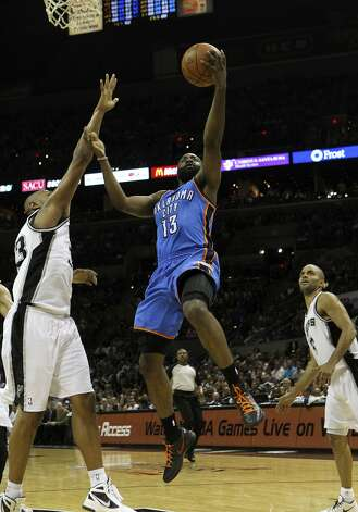 Oklahoma City Thunder's James Harden (13) lays the ball in against San Antonio Spurs' Boris Diaw (33) near San Antonio Spurs' Tony Parker (9) during the first half of game two of the NBA Western Conference Finals in San Antonio, Texas on Tuesday, May 29, 2012. Kin Man Hui/Express-News (Kin Man Hui / San Antonio Express-News)