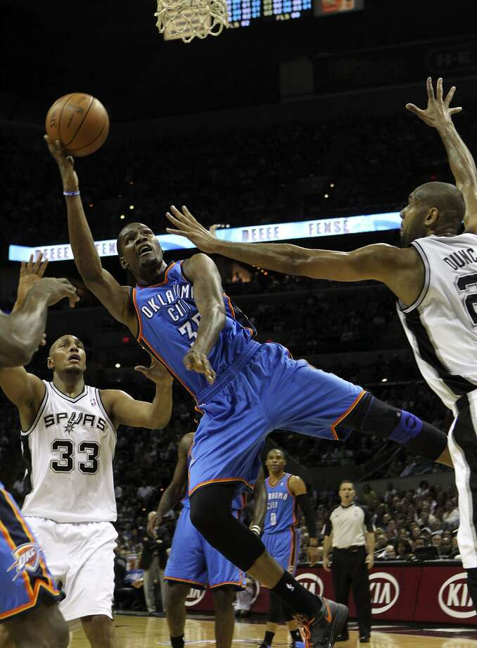 Oklahoma City Thunder's Kevin Durant (35) shoots near San Antonio Spurs' Boris Diaw (33) and San Antonio Spurs' Tim Duncan (21) during the first half of game two of the NBA Western Conference Finals in San Antonio, Texas on Tuesday, May 29, 2012. Kin Man Hui/Express-News (Kin Man Hui / San Antonio Express-News)