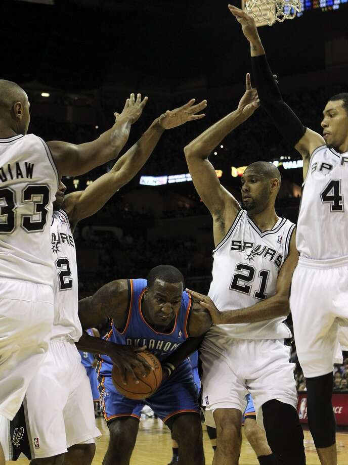 Oklahoma City Thunder's Kendrick Perkins (5) is under pressure from San Antonio Spurs' Boris Diaw (33), San Antonio Spurs' Kawhi Leonard (2), San Antonio Spurs' Tim Duncan (21) and San Antonio Spurs' Danny Green (4) during the first half of game two of the NBA Western Conference Finals in San Antonio, Texas on Tuesday, May 29, 2012. (Kin Man Hui / San Antonio Express-News)