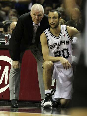 San Antonio Spurs coach Gregg Popovich stands near San Antonio Spurs' Manu Ginobili (20) during the first half of game two of the NBA Western Conference Finals in San Antonio, Texas on Tuesday, May 29, 2012. Kin Man Hui/Express-News (Kin Man Hui / San Antonio Express-News)