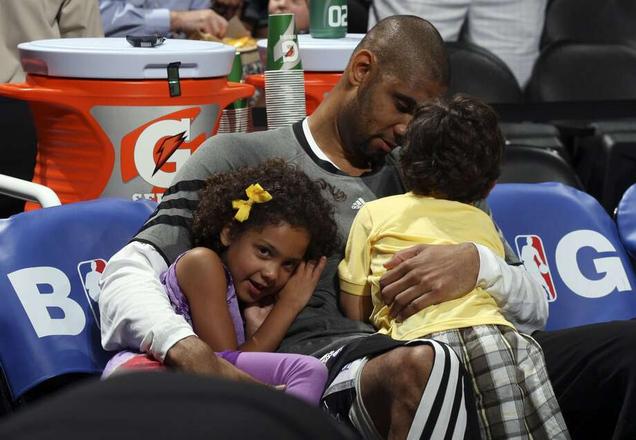 San Antonio Spurs' Tim Duncan (21) holds his daughter Sydney and his son, Draven,  before the first half of game two of the NBA Western Conference Finals in San Antonio, Texas on Tuesday, May 29, 2012. (Edward A. Ornelas / San Antonio Express-News)