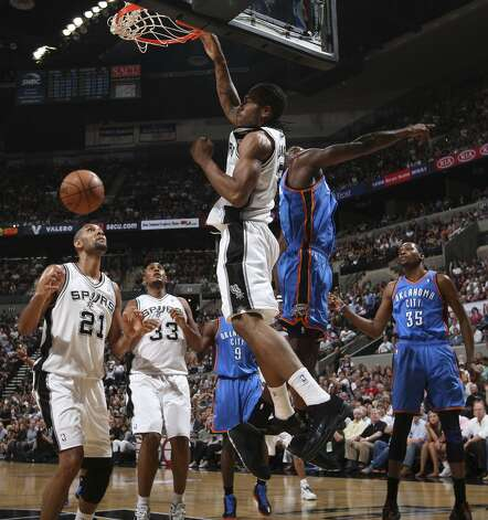 San Antonio Spurs' Kawhi Leonard (2) dunks over Oklahoma City Thunder's Kendrick Perkins (5) during the first half of game two of the NBA Western Conference Finals in San Antonio, Texas on Tuesday, May 29, 2012. (Edward A. Ornelas / San Antonio Express-News)