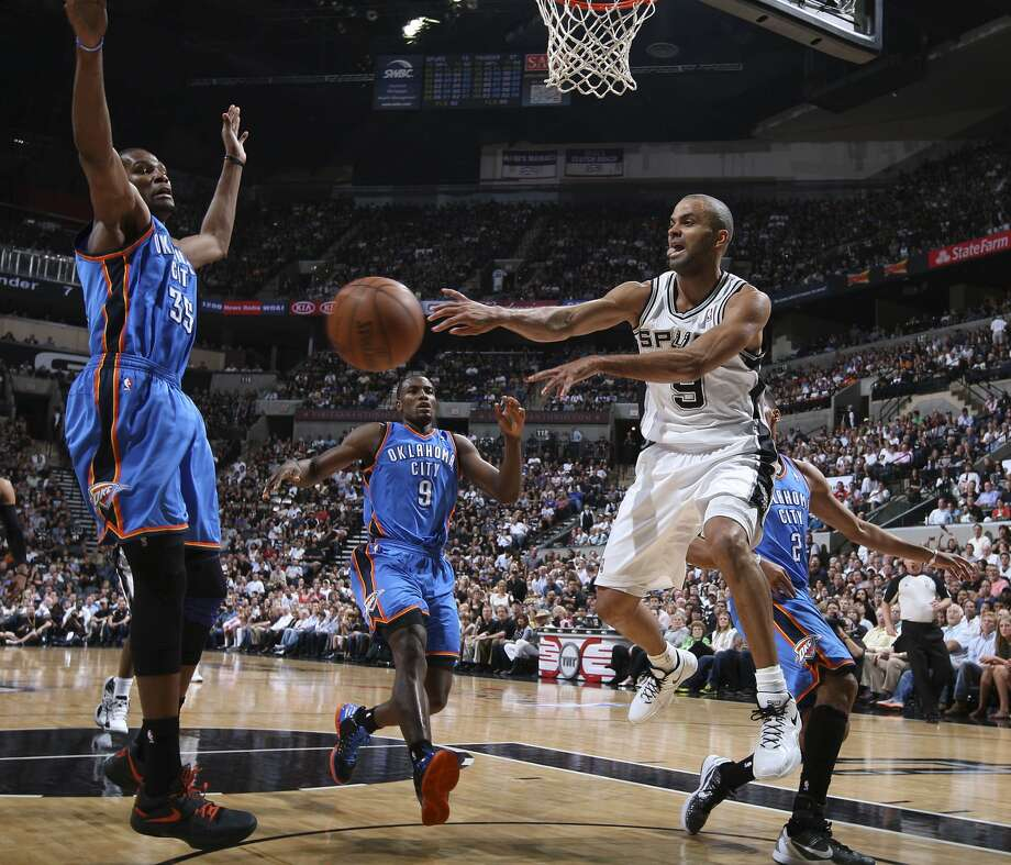 San Antonio Spurs' Tony Parker (9) passes around Oklahoma City Thunder's Kevin Durant (35) during the first half of game two of the NBA Western Conference Finals in San Antonio, Texas on Tuesday, May 29, 2012. Edward A. Ornelas/Express-News (Edward A. Ornelas / San Antonio Express-News)