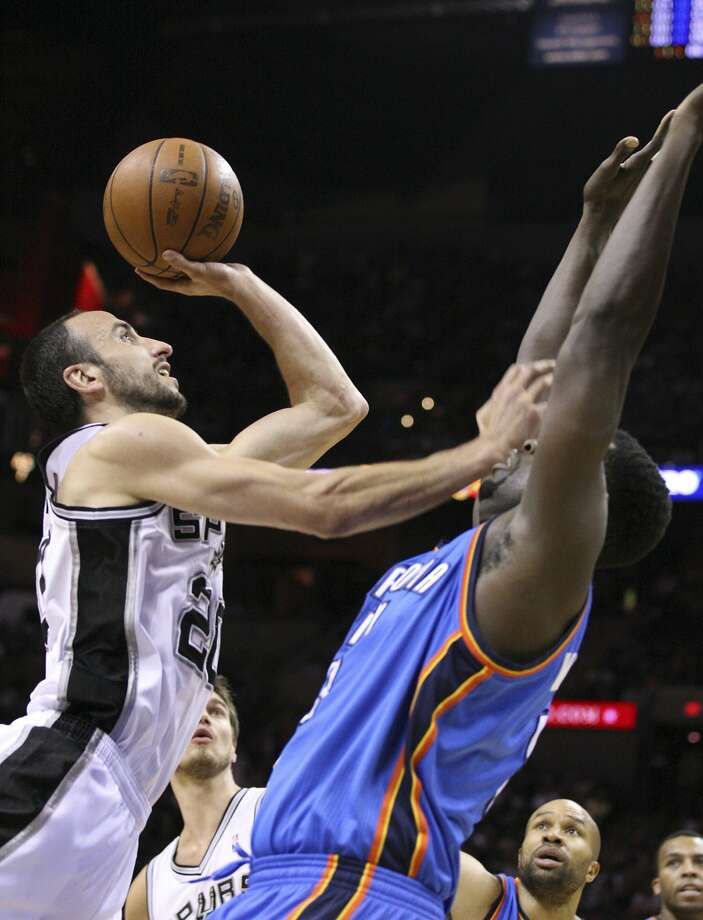 San Antonio Spurs' Manu Ginobili (20) shoots over Oklahoma City Thunder's Nazr Mohammed (8) during the first half of game two of the NBA Western Conference Finals in San Antonio, Texas on Tuesday, May 29, 2012. (Edward A. Ornelas / San Antonio Express-News)