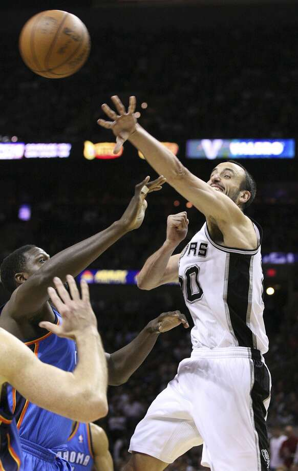 San Antonio Spurs' Manu Ginobili (20) passes over Oklahoma City Thunder's Nazr Mohammed (8) during the first half of game two of the NBA Western Conference Finals in San Antonio, Texas on Tuesday, May 29, 2012. (Edward A. Ornelas / San Antonio Express-News)