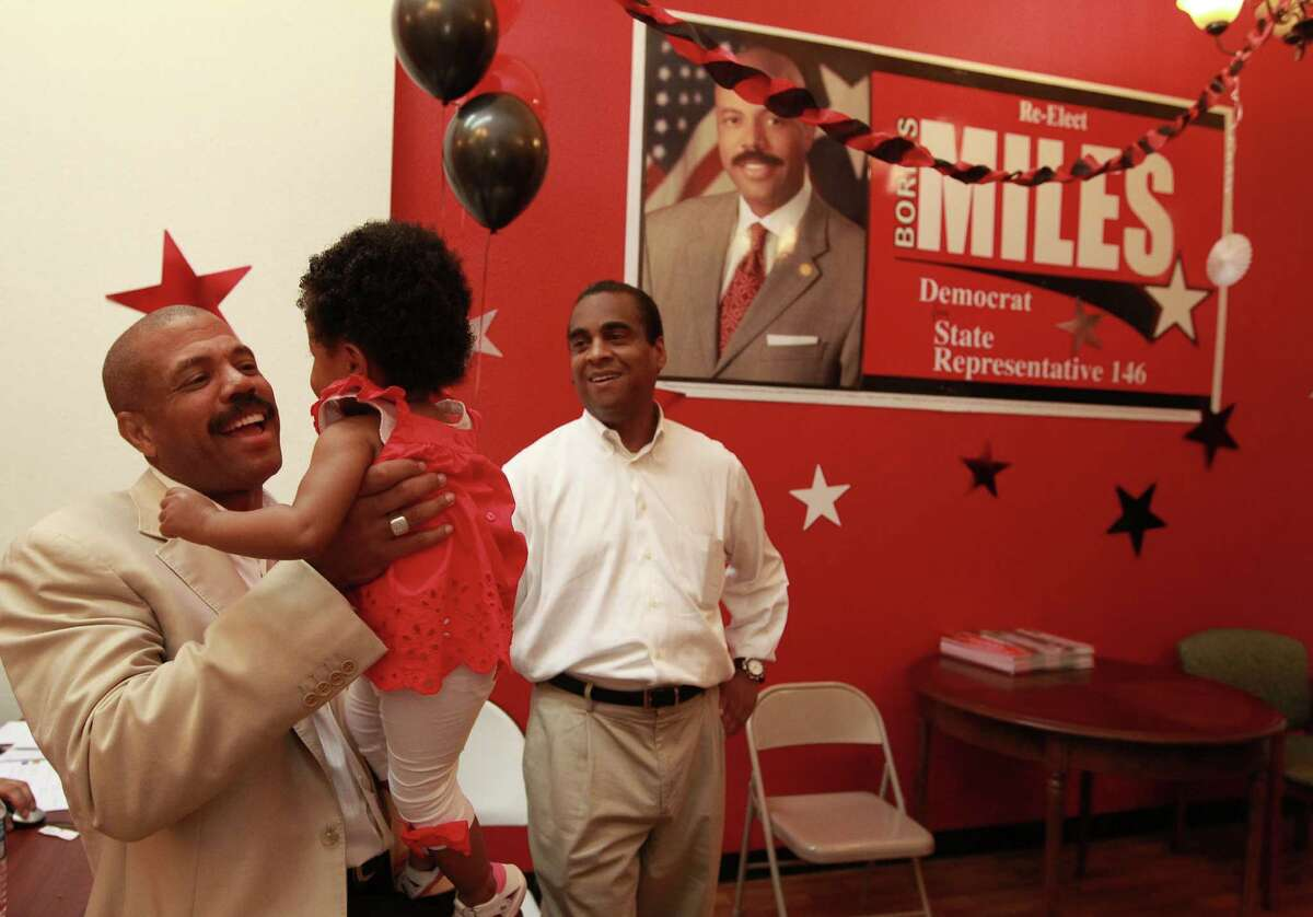 At his campaign headquarters, current District 146 State Representative Borris Miles, left, holds up his 11-month-old daughter Grace, next to his financial chair, Theldon Branch at his election night watch party, where he was running against Al Edwards, the former state rep. Tuesday, May 29, 2012, in Houston. Miles successfully challenged Edwards, who had held the Texas district 146 House of Representative seat for more than 25 years, in 2006. Edwards reclaimed the seat in 2008; then Miles won again two years ago. ( Johnny Hanson / Houston Chronicle )