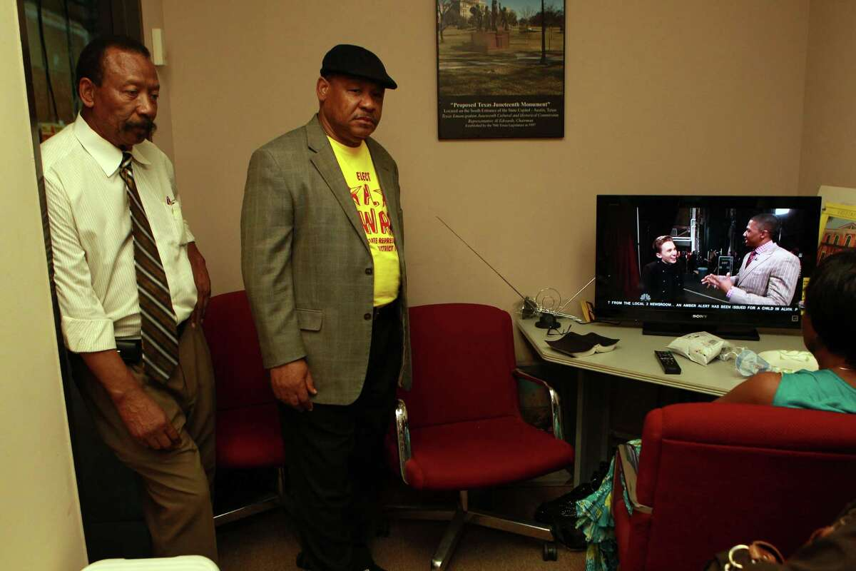Al Edwards, left, candidate for District 146 state representative, and his brother, David, watch election returns Tuesday night at his Houston headquarters. Edwards lost against longtime rival Borris Miles.