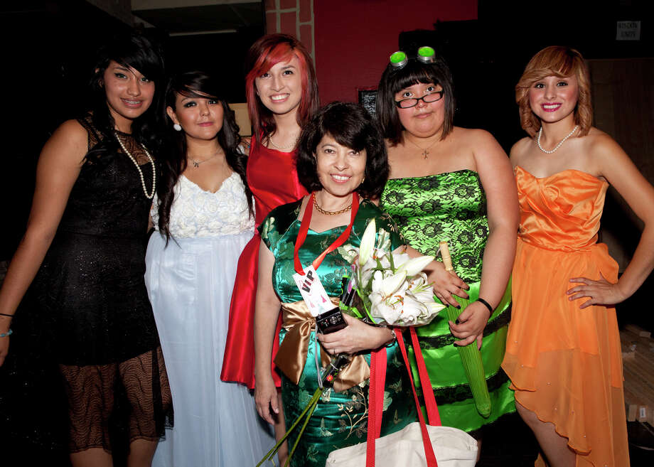 """SA Life/HEIDBRINK Fashion Design instructor Sandy Starr, center, gets together backstage with student designers, from left, Kimberly Munoz,  Alyssa Lombrano, Ashley Shearer, Kristina Carranza and Genesis Dorado at the Thomas Jefferson High School 11th Annual """"All That Style"""" 2012 Fashion Show. Photo by Jamie Karutz. Photo: Jamie Karutz / Special to the Express-News"""