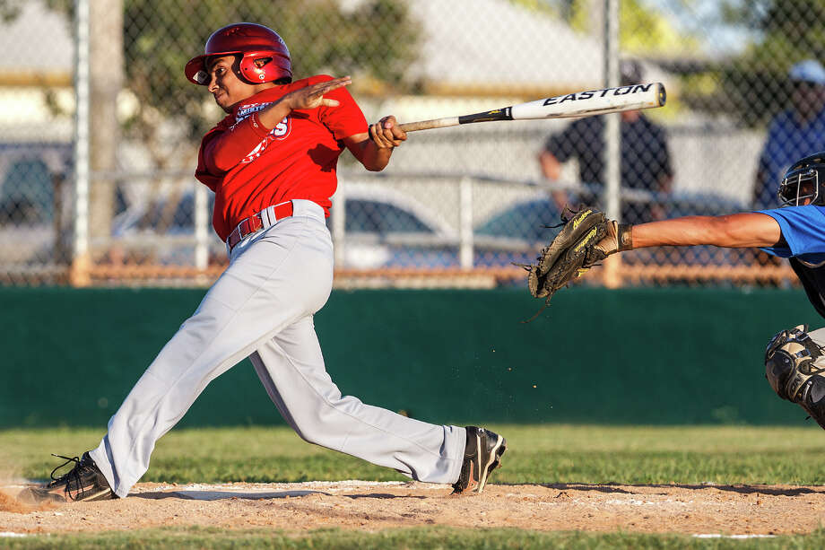 Lee's Sam Camacho, playing for the East all-stars, drives in a run with a double during the Valley-Hi Optimist all-star game at Tejeda Sports Complex on May 29, 2012. The West won the game 16-2. Photo: MARVIN PFEIFFER, Marvin Pfeiffer/ Mpfeiffer@express-news.net / Express-News 2012